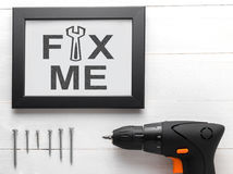 Fix me text on black frame with equipments. Stock Images
