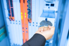 Fix network switch in data center room Stock Photos