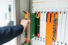 Fix network switch in data center room Royalty Free Stock Images