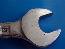 FIX THE PROBLEMS! (Wrench). Wrench Isolated On Blue Stock Images