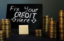 Fix your credit here handwritten sign and money