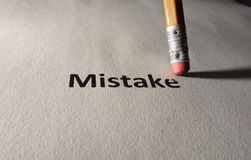 Fix your mistakes. Mistake text on paper being erased by a pencil Stock Photos