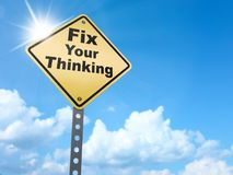 Fix your thinking sign. On blue sky background,3d rendered stock illustration