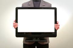 Fixation d'homme dans l'affichage à cristaux liquides TV de mains Photos libres de droits