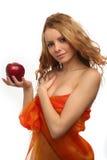 Fixation de fille dans sa pomme de rouge de main photos stock