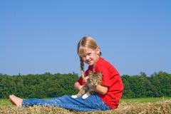 Fixation de fille de ferme son minou. Photo libre de droits