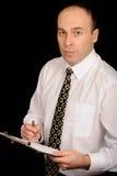 fixation de planchette d'homme d'affaires photo stock