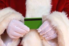 Fixation de Santa par la carte de crédit Photos stock
