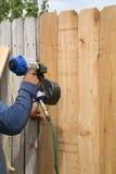 Fixation en bois de barrière Photos libres de droits
