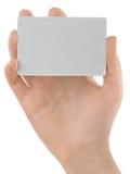 Fixation femelle par la carte de crédit de main Photos libres de droits