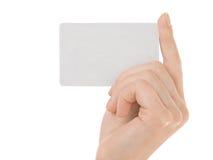 Fixation femelle par la carte de crédit de main Photographie stock