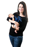 Fixation heureuse de maman sa chéri nouveau-née Photos libres de droits