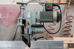 Fixed circular buzz saw with electric motor. Engine and green red buttons royalty free stock image