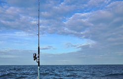 Fixed fishing rod set up in front of the sea Stock Image