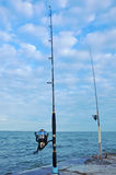 Fixed fishing rod set up in front of the sea Royalty Free Stock Image