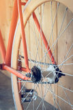 Fixed gear bicycle parked with wood wall, close up image Stock Photography