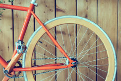 Fixed gear bicycle parked with wood wall, close up image Royalty Free Stock Images