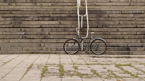 Fixed gear black retro style bicycle standing on old urban vintage street against stairs background Royalty Free Stock Image