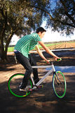 Fixed Gear Cyclist. Young man doing tricks on his fixed gear bicycle Royalty Free Stock Photo