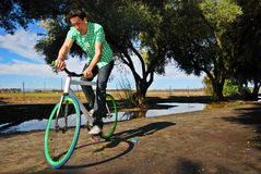 Fixed Gear Cyclist. Young man balancing on his fixed gear bicycle royalty free stock image