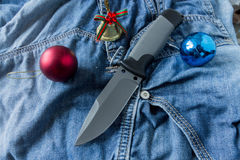 Fixed knife with Christmas toys. Army knife Stock Photo