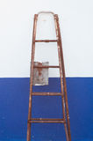 Fixed ladder. On blue and white wall Royalty Free Stock Images