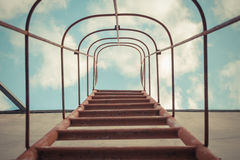 Fixed ladder upto sky. Fixed ladder red color upto the blue sky with cloud , process in vintage style stock photos