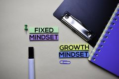Fixed Mindset or Growth Mindset text on sticky notes with office desk concept stock photos