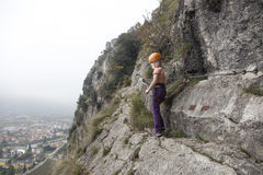 Fixed rope route. Girl is looking back on fixed rope route royalty free stock photos