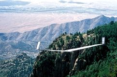 A Fixed-Wing Glider Launches From Sandia Crest, NM. A fixed-wing glider pilot steps into his body harness after a successful launch from Sandia Crest @ 10,678` Royalty Free Stock Photography
