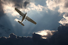 Fixed wing plane against a stormy sky. Small fixed wing plane against a stormy sky Stock Images