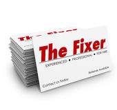 The Fixer Business Card Stack Problem Solver Solution. The Fixer words on a business card in stack or pile for a professional who can solve a problem or make Stock Images