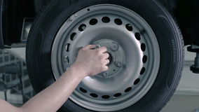It fixes the tire using a power screwdriver. stock video