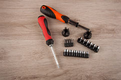Fixing accessopries lay on wooden table Royalty Free Stock Image