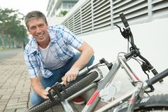 Fixing bike Stock Photo