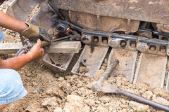 Fixing bulldozer wheel with gas cutting torch Royalty Free Stock Photos