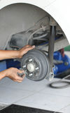 Fixing A Car Brakes In Auto Mechanic Shop Stock Photography