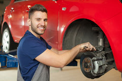 Fixing a car brakes Royalty Free Stock Images