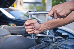 Fixing a car. Check the condition of the car engine Royalty Free Stock Image