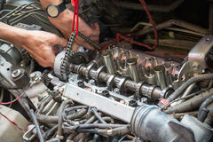 Fixing car engine using local method in Thailand Royalty Free Stock Photography