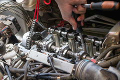 Fixing car engine using local method in Thailand Stock Photography