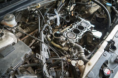 Fixing car engine using local method in Thailand Royalty Free Stock Image