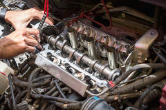 Fixing car engine using local method in Thailand Royalty Free Stock Photos