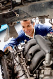 Fixing car mechanical problem Stock Photography