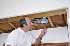 Fixing ceiling light Stock Images