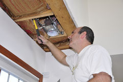 Fixing ceiling light royalty free stock image