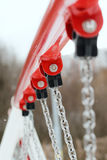 Fixing chain to crossbar swing Royalty Free Stock Photo