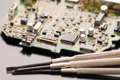 Fixing A Circuit Board. With Small Tools Stock Photo
