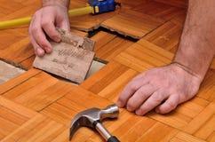 Fixing Damaged Floor Stock Photos