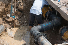 Fixing drainage pipe for dirty water Stock Photography